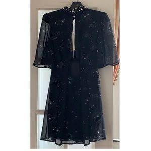 Topshop Dresses - Black Topshop dress w/ stars theme design - size 4